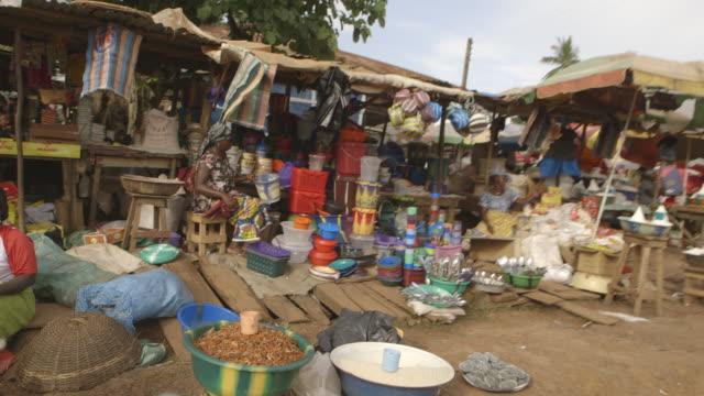 POV shot showing market stalls in Kenema, Sierra Leone.