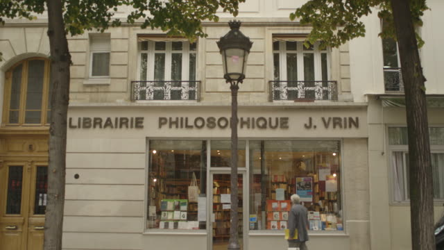 shot showing people browsing in and going into a bookshop in paris france fkax912p clip taken from programme rushes abma938f - philosophy stock videos & royalty-free footage