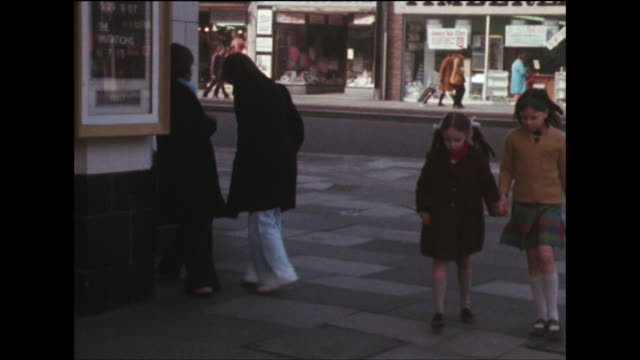 shot showing two young girls queuing to enter a cinema. - film industry stock videos & royalty-free footage