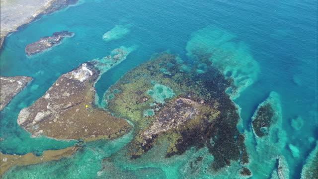 Shot taken by drone; Long shot of the coast of the Shakotan Peninsula, Hokkaido, Japan.