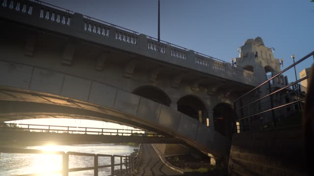 a shot taken under tthe brudge in downtown calgary by the bow river - calgary stock videos & royalty-free footage