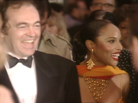vídeos de stock, filmes e b-roll de shot through crowd brian gibson and lynn whitfield in crowd smiling and greeting guest at the director's guild of america theater - director's guild of america