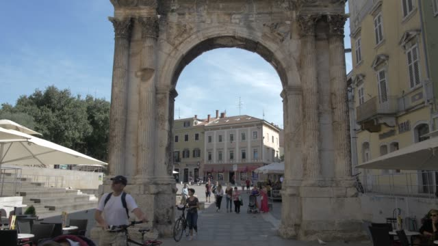 shot through the arch of the sergii in old town, pula, istria county, croatia, adriatic, europe - square stock videos & royalty-free footage