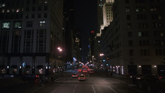 pov shot traveling down fifth avenue in new york city at night. - st. patrick's cathedral manhattan stock videos and b-roll footage