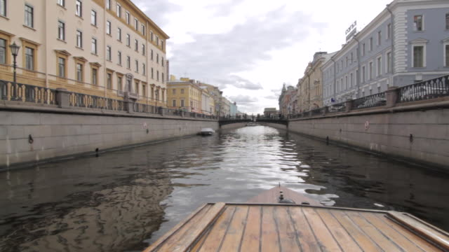 pov shot travelling along a waterway in st petersburg. - boat point of view stock videos & royalty-free footage