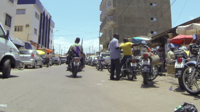POV shot travelling along busy streets in Lome, Togo.