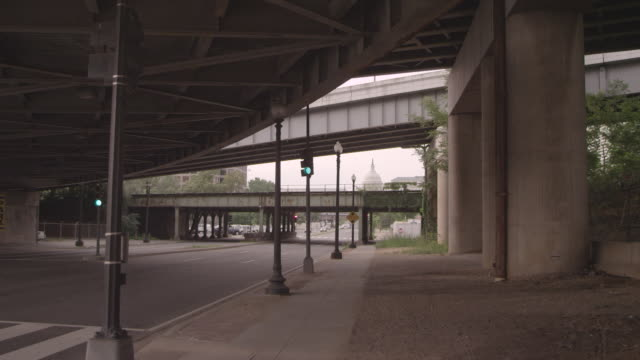 WS Shot under an overpass with US Capitol in background / Washington DC, United States