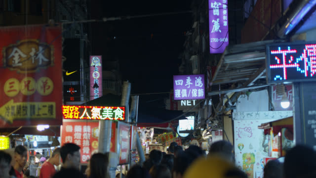 pov shot walking through raohe night market - taiwan stock videos & royalty-free footage
