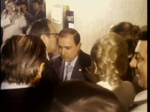 shot zeroes in on joe colombo standing by a wall and surrounded by the press in the hallway of a courthouse. a man walks up to him and whispers in... - organised crime stock videos & royalty-free footage