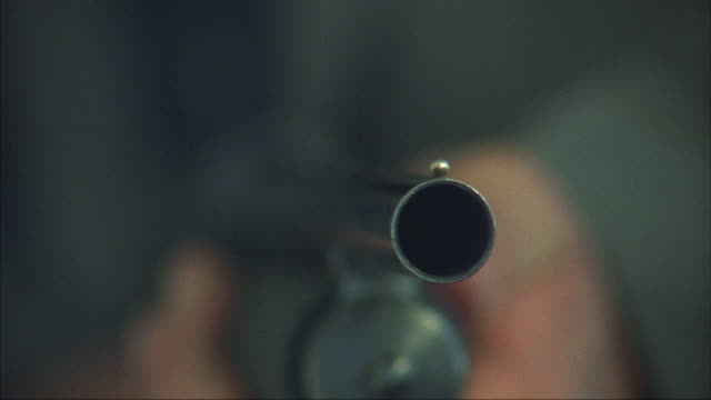 a shotgun fires three times. - sparare video stock e b–roll