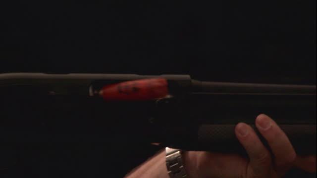 shotgun shells fall from the barrel of the gun with each shot. - shotgun stock videos & royalty-free footage