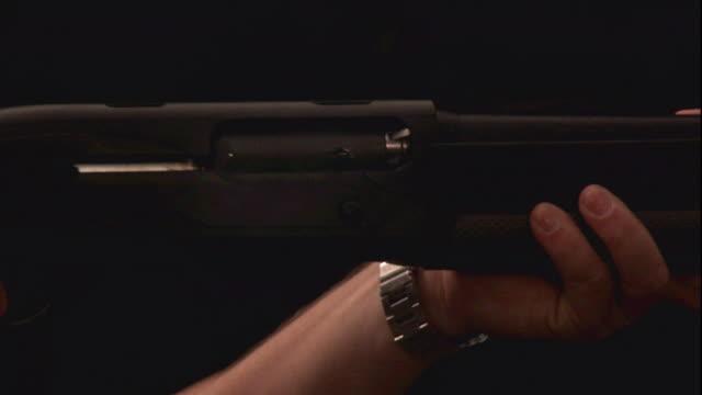 stockvideo's en b-roll-footage met shotgun shells fall from the barrel of the gun with each shot. - jachtgeweer