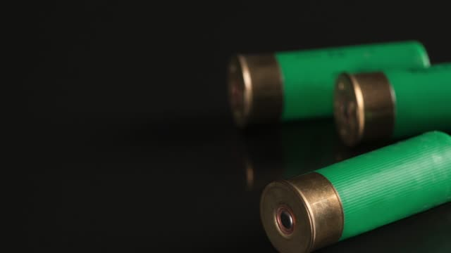 shotgun shells on a black background - cartridge stock videos and b-roll footage