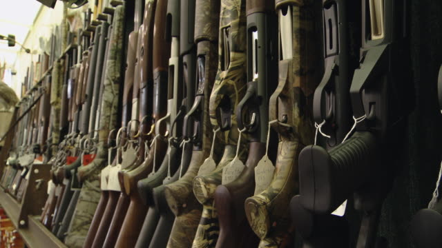 shotguns all aligned along a wall - weaponry stock videos & royalty-free footage