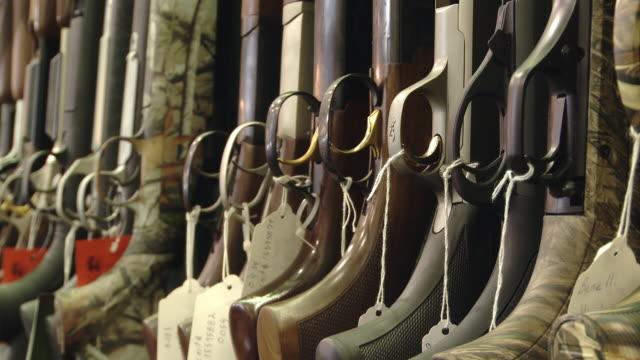 Shotguns all aligned along a wall