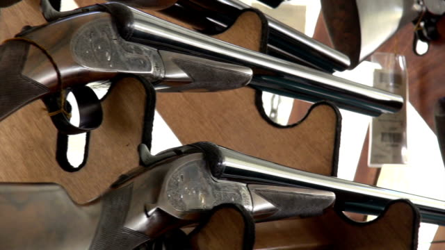 shotguns on display - weaponry stock videos & royalty-free footage