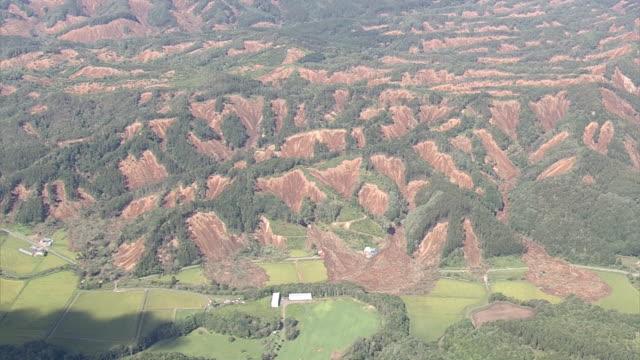 aerial of landslides location atsuma town hokkaido prefecture shot date 6th september 2018 a strong earthquake struck hokkaido northern japan shortly... - 自然災害点の映像素材/bロール