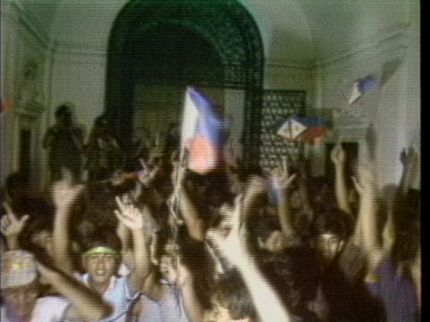 shots a huge crowd enters presidential malacanang palace through arched doorways and once inside are seen waving flags and flashing the l sign,... - human finger stock videos & royalty-free footage