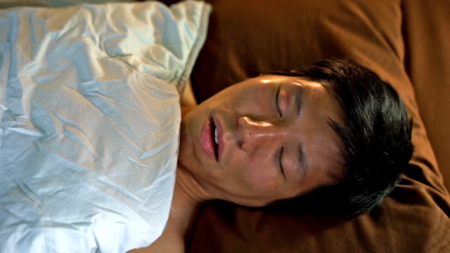 2 shots asian man sleeping and snoring - snoring stock videos and b-roll footage