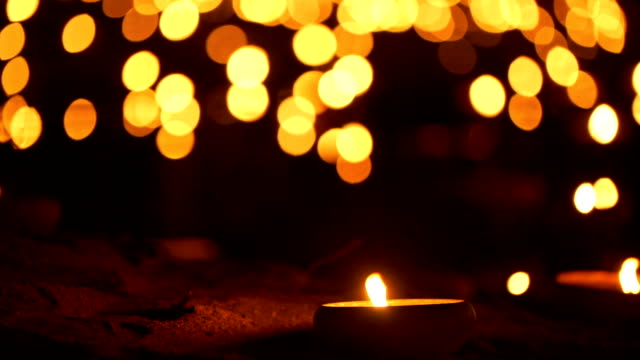 2 shots candle with bokeh background - memorial event stock videos and b-roll footage