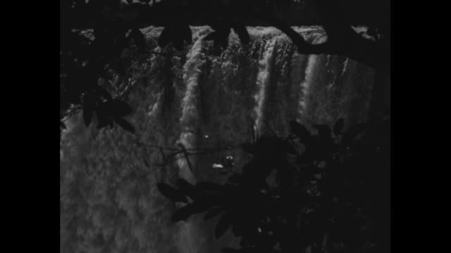 shots from various angles of victoria falls interspersed with shots of george viewing the falls - victoria falls stock videos and b-roll footage