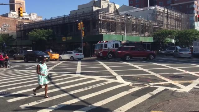 father sprays son with fire hydrant to cool off in Harlem an FDNY truck on its way to the scene in Harlem heat wave hits New Yorkers in the subway...