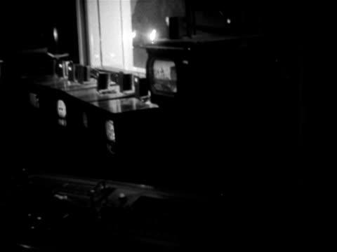 vídeos de stock e filmes b-roll de shots inside a bbc studio gallery as a programme is recorded 1953 - bbc