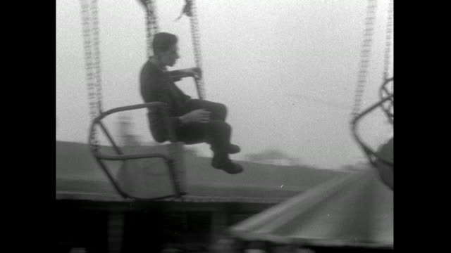 b&w shots inside spinning chair swing ride at battersea park fun fair; 1953 - 1950 stock videos & royalty-free footage