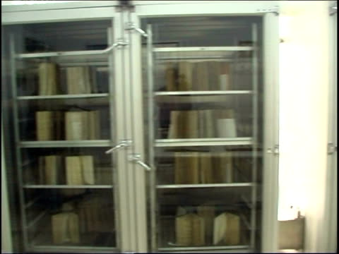 shots inside the preservation room in the hawza ilmiya islamic library in qom. manuscripts and books are are stacked in locked temperature controlled... - orthographic symbol stock videos & royalty-free footage