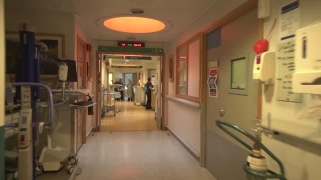 pov shots moving down a hospital ward corridor - nhs stock-videos und b-roll-filmmaterial