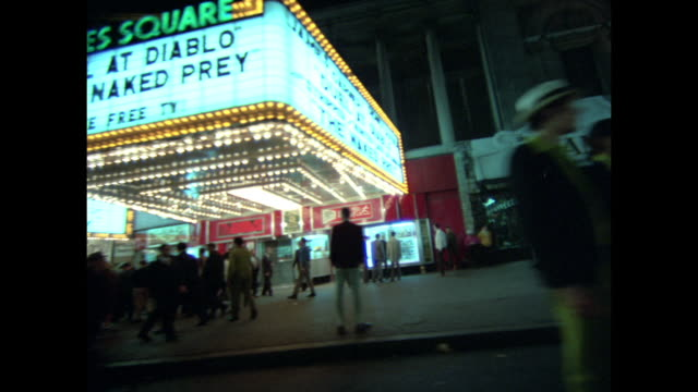 """shots of 42nd street at night; different theatres """"exclusive new york showing pussy galore 50000 bc in color"""" """"kodak film cameras"""" """"lola's pizza""""... - 42nd street stock videos & royalty-free footage"""