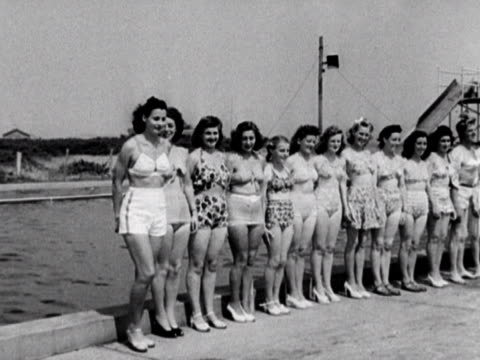 Shots of a beauty contest at the Coronation holiday camp on Hayling Island The girls wear bathing suits and one of them parades up to the judges 1948