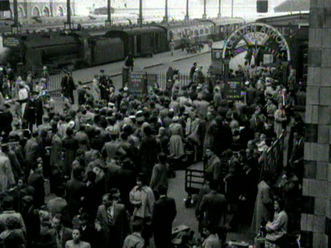 shots of a busy victoria station as people prepare to leave london for the bank holiday weekend. 1954. - number of people stock videos & royalty-free footage