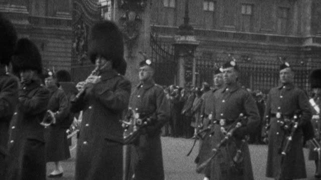 shots of a marching band marching down the street members with trumpets drums and other instruments and wearing bearskin tall caps crowd of people in... - 1925 stock videos & royalty-free footage