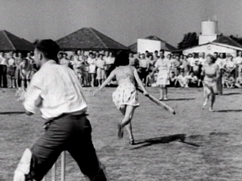 shots of a mixed cricket match at the coronation holiday camp on hayling island. 1948. - holiday camp stock videos & royalty-free footage