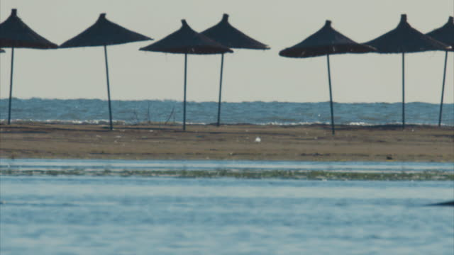 Shots of a new holiday resort and nearby fishermen in Karavasta National Park in Albania