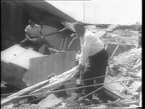vidéos et rushes de shots of a still standing hospital where wounded citizens are treated / close up shots of children and elderly being attended to / shots of people... - 1944