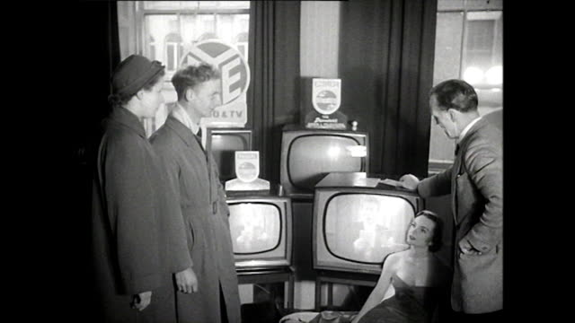 stockvideo's en b-roll-footage met b&w shots of a television shop; ireland, 1957 - etalage