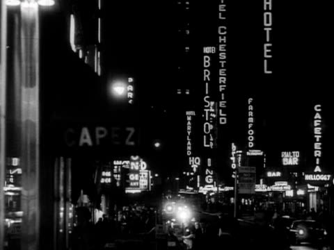 shots of advertising boards and theatre billboards on broadway 1957 - 1957 bildbanksvideor och videomaterial från bakom kulisserna