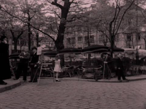 shots of an open air cafŽ in a parisian square. 1952. - artist stock videos & royalty-free footage