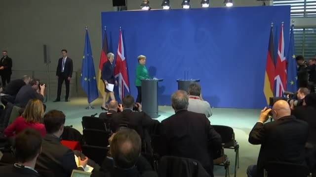 Shots of Angela Merkel and Theresa May arriving at their joint press conference in Berlin Germany