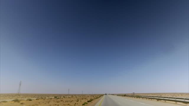 shots of barren desert roads in libya - 2018 video stock e b–roll