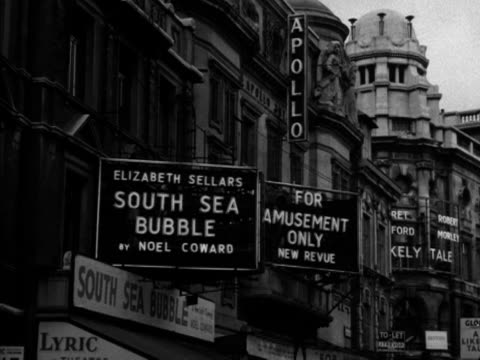 Shots of billboards on various West End theatres advertising their latest productions 1956