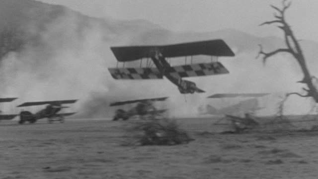 ms ts pan shots of biplane in air and crashing to ground - air vehicle stock videos & royalty-free footage