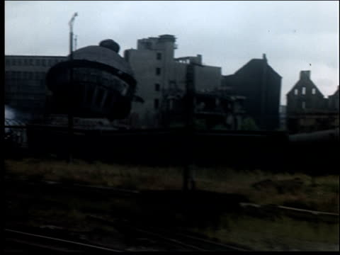 shots of bombed out towns, taken from train. - postwar stock videos & royalty-free footage