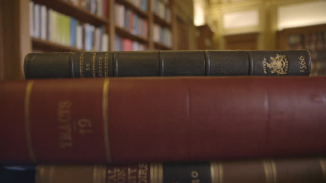 pov shots of books being wheeled around on trolley - library stock videos & royalty-free footage