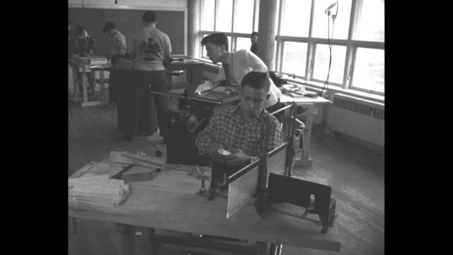 shots of boys working on wood projects with various machinery incl one boy on crutches and one using a drill press - crutch stock videos & royalty-free footage