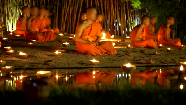 2 Shots of Buddhism, Buddhist novices are meditating in Asalha Puja day at Night