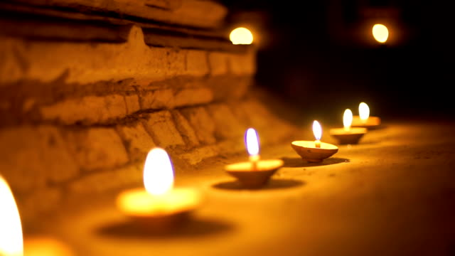 2 shots of buddhism candle in temple - candlelight stock videos & royalty-free footage
