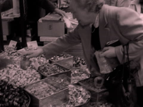 shots of busy market stalls in paris. 1952. - dairy product stock videos & royalty-free footage